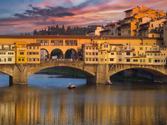 A Fiery Florentine Sunset (RobertCross1 (off and on)) Tags: 40150mmf456mzuiko arno em5 europe firenze florence italia italy microfourthirds omd olympus pontevecchio toscana tuscany atardecer boat clouds landscape medieval mirrorless puestadelsol reflection river sunset tramonto water