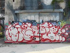 118 (en-ri) Tags: dj gruff reser rosso bianco nero arrow throwup torino wall muro graffiti writing parco dora