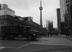 The Tower (Alex Luyckx) Tags: toronto ontario canada downtown urban metro streets random afternoon cloudy winter christmas wandering walk mamiya mamiyam645 m645 slr 120 645 6x45 mediumformat mamiyasekorc45mm128n foma fomapan fomaretropan320 retropan320 asa320 kodak kodakd76 d76 stock 10 gossenlunasixf epsonv700 adobephotoshopcc bw blackwhite film filmphotography believeinfilm filmisalive filmisnotdead
