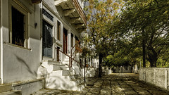 2814CE Autumn in Apeiranthos (foxxyg2) Tags: stone marble buildings roads history apeiranthos trees naxos cyclades greece greekislands islandhopping islandlife seclusion autumn niksoftware dxo dfine2 colorefex light shade sunlight shadows