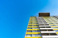Arthur (100 Real People) Tags: goldenlaneestate nikond750 nikkor1835f3545 kingarthurhouse architecture london city socialhousing yellow blue rampskijump flats towerblock