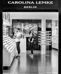 Carolina Lemke (Bart van Hofwegen) Tags: glasses store shop sunglasses people city urban streetphotography urbanphotography monochrome blackandwhite malaga málaga