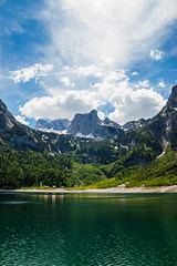 a distant home iii (hannes-flo) Tags: landscape waterscape lake beautiful spring summer green grass forest wide angle mountain mountainscape range alps austrian austria gosau gosausee dachstein blue sky warm