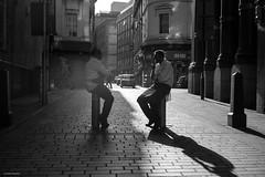 Butchers Break (Silver Machine) Tags: liverpool streetphotography street candid butchers men sitting cobbledstreet backlight sunshine shadows mono monochrome blackwhite bw fujifilm fujifilmxt10 fujinonxf35mmf2rwr