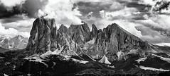 These Mountains again... (Ody on the mount) Tags: anlässe berge blackwhite dolomiten drama em5ii fototour fünffingerspitze gipfel gröden grödnertal himmel langkofel langkofelgruppe mzuiko6028 omd olympus panorama plattkofel südtirol urlaub wolken zahnkofel bw clouds monochrome mountains peaks sw sky