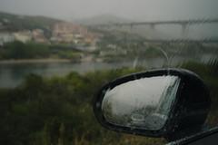And it Started to Rain III (Stefan Waldeck) Tags: window rain water river riverduoro bridge houses trees bushes mirror reflections drops car hill duorovalley portugal 2019 netzki stefan waldeck stefanwaldeck