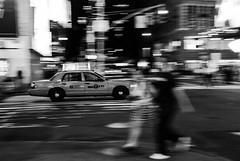 Into the rush (Aurélien B.) Tags: usa ny newyork city people blackandwhite woman man blur lights taxi streetphotography