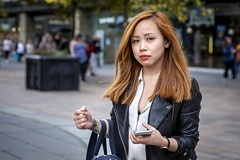Sauchiehall Street (Leanne Boulton) Tags: urban street candid portrait portraiture streetphotography candidstreetphotography candidportrait streetportrait eyecontact candideyecontact streetlife woman female girl face eyes expression mood emotion feeling smartphone shopping redhead ginger colourful hair style fashion tone texture detail depthoffield bokeh naturallight outdoor light shade city scene human life living humanity society culture lifestyle people canon canon5dmkiii 70mm ef2470mmf28liiusm colour glasgow scotland uk