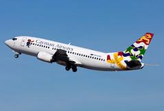 VP-CKZ Cayman Airways B733 (twomphotos) Tags: plane spotting mia kmia rwy27 departure climbout blue sky aircraft cayman airways caymanairways boeing b733