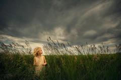 Nebraska ({jessica drossin}) Tags: jessicadrossin portrait nebraska face child girl sky tall grass profile ominous wwwjessicadrossincom