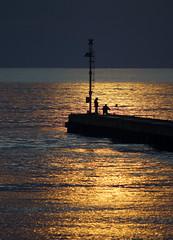 Fishers in a golden sea (Darea62) Tags: sunset people bridge pier jetty sonyalpha77 mare gold seascape montignoso versilia cinquale tramonto oro dream mood