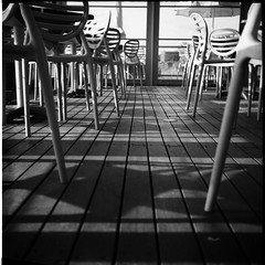 Shadows On The Floor (Manuel&TheSea) Tags: monochrome mediumformat filmphotography ishootfilm tlr analoguephotography analogue iso125 bw rodinal125 rodinal ilfordfilm ilford fp4 ilfordfp4 somberthiotparis luxoflex atos2 6x6 squareformat vintagecamera 50scamera shadows chairs boards