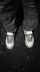 Feet at Night: No.187 (WatermelonHenry) Tags: nike trainers bw blackandwhite povpointofview pov legs jeans denim nikeswoosh niketrainers twofeet pair shoes garden feet feetatnight nighttime night footwear