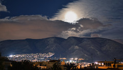 moon playing hide and seek with the clouds (athanecon) Tags: ymittos ilioupoli greece moon fullmoon moonrise hideandseek clouds citylights alimos athens light colours night nightphotography mountain sky nubes ciel cielo luna whitecloud cityscapes pillars pylons nikon nikonphotography nikond5600 nikon35mm urban landscape urbanlandscape cityscape skyscape