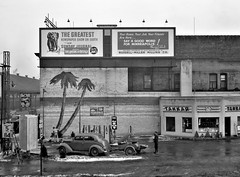 Far Away Places: A Gas station in Minneapolis, Minnesota, December 1937. (polkbritton) Tags: johnvachon 1930s fsaowi classiccars minnesotahistory petroliana libraryofcongresscollections streetphotography advertising explore