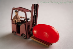 A Lift Truck and a Jelly Bean (13skies) Tags: lifttruck lift move carry load towmotor job food candy red light driving operating macroscopic sonyalpha100 sony homodelrailroadfigures smaller play plan pose set macro modelrailroadfigures