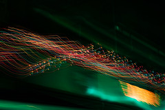 Trailing Christmas Lights (mixboul) Tags: night street christmas lights colors long exposure red green orange building sign motion blur abstract nikon d3500 50mm trails trailing xmas patras