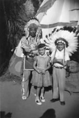Knott's Berry Farm (jericl cat) Tags: october 1957 1950s ghosttown knotts berryfarm history historic photo candid vintage indian native american headdress pose feathers teepee chief