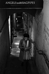 Royal Mile, Edinburgh(4) (S.R.Murphy) Tags: edinburgh fujifilmxf35mmf2 night nov2019 urban urbanlandscape fujifilmxt2 nightphotography socialdocumentary streetphotography street people woman female angelswithbagpipes bnw bw blackandwhite monochrome