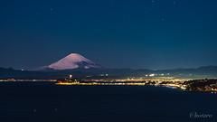 Mount Fuji and  Enoshima island at night (aotaro) Tags: ilce7m3 night kanagawa mountfuji sony enoshima snowy miura earlymorning longexposure light enoshimaseacandle ocean enoshimaisland fe90mmf28macrogoss seacandle fujisan fuji sky osakipark sea snow japan mountain