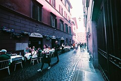 Roma (goodfella2459) Tags: nikonf4 afnikkor14mmf28dlens lomochromepurplexr100400 35mm c41 film analog colour purple city streets roma italy pedestrians people rome buildings manilovefilm