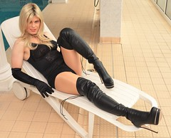 Relaxing by the pool at Bournemouth. Again undies from https://berditalingerie.com/ and no I didn't go in like this before you ask. (Miss Nina Jay) Tags: boots gloves tights corselet