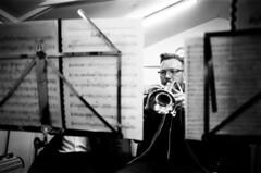 Knottingley Silver Band in rehearsal: cornet player (I ♥ Minox) Tags: film 2019 tmax kodaktmax400 olympusom2n knottingleysilverband knottingley brassband monochrome olympus om2n om2 kodak windband music musician musicians rehearsal yorkshire westyorkshire olympusom2 400asa