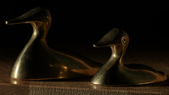 Shapes described by light (PChamaeleoMH) Tags: flash ducks brass macro ornament home indoors