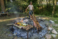 Lamb roast (tmeallen) Tags: lambroast grilledvegetables firepit openflames traditionalfood ashes rocks manwithshovel cooking patagoniahouse coyhaique patagonia chile travel