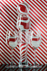 xmas refraction (le cabri) Tags: glass illusion water abstract xmas christmas lines art blending redcolor composition design distorted refraction drink glasses drinkingglasses pattern reflection science transparent striped