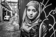 Naziyah (Leanne Boulton) Tags: portrait beauty woman people leanneboulton naziyahmahmood urban street portraiture streetphotography streetportrait streetlife eyecontact locationportrait location alleyway female girl pretty face eyes expression mood emotion feeling beautiful style fashion leather graffiti juxtaposition perspective hijab character stunning personality astrophysicist scientist talent tone texture detail depthoffield bokeh naturallight outdoor light shade city scene human life living humanity society culture lifestyle canon canon5dmkiii 35mm ef2470mmf28liiusm black white blackwhite bw mono blackandwhite monochrome glasgow scotland uk
