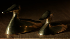 Side by side (sculptural light) (PChamaeleoMH) Tags: flash ducks brass macro ornament home indoors