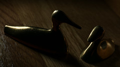 Courting (shadowy) (PChamaeleoMH) Tags: macro flash ducks brass ornament home indoors