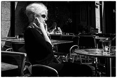 The sound of silence (Loek van Straaten) Tags: lübeck germany street streetphotography candid city people woman café phone mobile ear finger call silence blackandwhite black white bw monochrome loek vanstraaten