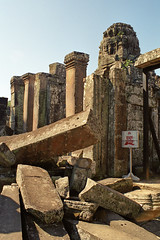 A danger sign amongst the ruins of Bayon Temple, Angkor Wat, Cambodia (Scott Mundy) Tags: cambodia angkor wat bayon temple danger sign khmer architecture stone faces heads head face carved canon eos300 slr unesco world heritage site