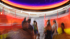 at the fun park (JimmyKteniadis) Tags: lunapark fun nikonz6 nikkorz 50mm handheld colorful kremasti rhodes greece motionblur blur streetphotography orange people mk funpark