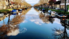 Clouds, water, boats and houses. (carlo pronk) Tags: water denhelder iphone8 trees reflection clouds boats wolken boten reflectie