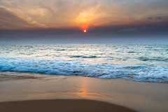 Smoky Red Summer Sun Seascape (Merrillie) Tags: bronze purple dawn newsouthwales sea nsw summer beach ocean coastal sky killcarebeach killcare daybreak sunrise cloudy australia hazy bushfiresmoke red rocks earlymorning coast blue clouds landscape outdoors nature pink water waves morning waterscape smoky centralcoast seascape seaside