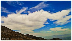 Haciendo trekking, mirando el cielo / Trekking, looking at the sky (Claudio Andrés García) Tags: nubes clouds cielo sky skyscape paisaje landscape montaña mountain naturaleza nature primavera spring fotografía photography shot picture trekking cybershot flickr