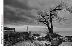 Danger! Pier Closed (jwvraets) Tags: grimsby pump house pier closed sign tree rocks lakeontario clouds dark cloudy opensource rawtherapee gimp nikon d800 afsdxnikkor1224mm140 blackandwhite monochrome bw