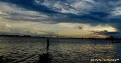 Sunset over Bridge Jules Wiijdenbosch on the Suriname River, Paramaribo, Suriname (Sebastiao P Nunes) Tags: puente ponte bridge sunset pordosol solpoente atardecer entardecer commewijne suriname paramaribo juleswijdenbosch ballastnedam meerzog riosuriname surinamriver