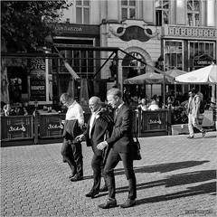 Three of a kind (John Riper) Tags: budapest street bw white black square photography mono zwartwit vierkant straatfotografie johnriper monochrome john office hungary fuji candid guys fujifilm gentlemen 18135 xt1 riper walking