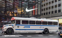 NYPD Police Bus on Fifth Avenue, Midtown Manhattan, New York City (jag9889) Tags: 2019 20191204 5thavenue auto automobile bus car fifthavenue finest firstresponder lawenforcement manhattan midtown ny nyc nypd newyork newyorkcity newyorkcitypolicedepartment nike outdoor policedepartment transportation truck usa unitedstates unitedstatesofamerica vehicle jag9889