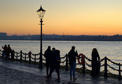 By the river at sunset (Tony Worrall) Tags: liverpool merseyside mersey scouse welovethenorth nw northwest north update place location uk visit area attraction open stream tour photohour photooftheday pics country item greatbritain britain british gb capture buy stock sell sale outside dailyphoto outdoors caught photo shoot shot picture captured ilobsterit instragram england candid people chain river wet water sunset settingsun atmosphere color colourful lamp lights riverside rivermersey
