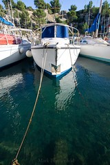 Blue Boat (MAPerature) Tags: cassis france blue boat water wide angle rope dock docked reflection