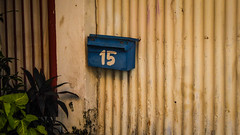 Number 15 (Theen ...) Tags: number letterbox corrugated penang blue painted plants rusty mailbox 15 armenianstreet green handpainted yellow orange fence