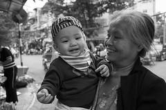 R0060235-1 (nae2409) Tags: child grandmama boy smile blackandwhite portrait ricoh gr2 hanoi vietnam