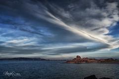 The sky over lake Titicaca (marko.erman) Tags: laketiticaca peru southamerica latinamerica travel lateafternoon sky clouds shore rocks sony