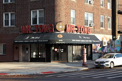 Mr Tong with signage evoking an old Chinese coin, Windsor Terrace, Brooklyn (Eating In Translation) Tags: windsorterrace translation brooklyn newyork usa