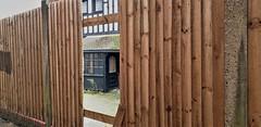 The Backdoor (standhisround) Tags: fencedfriday behindfences fences building door backdoor windows woodenfence wood edgware greaterlondon england uk hff reflections